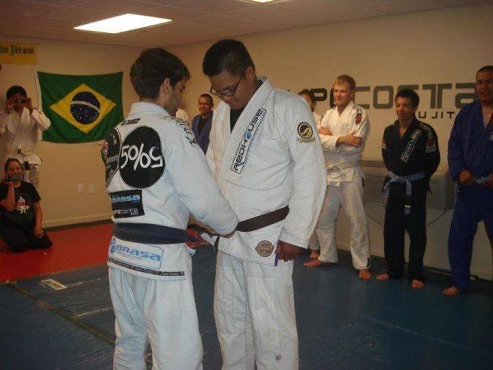 Brendon Barlow receiving brown belt from Felipe Costa