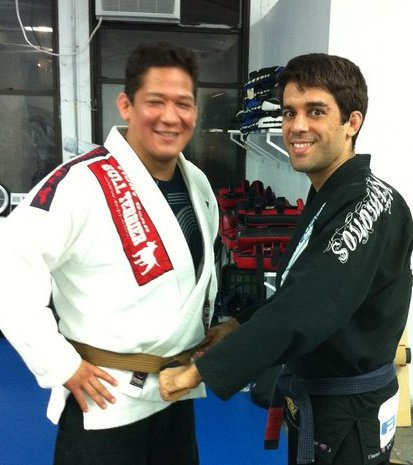 Christian Montes receiving his brown belt from Felipe Costa